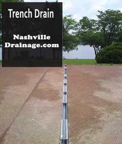 This is a Trench Drain. There is a photo of a driveway with the trench drain running across it.